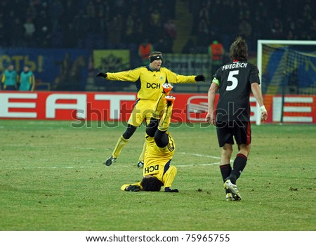 KHARKIV, UA - FEBRUARY 17: FC Metalist Kharkiv FW Taison's head-stand during Europa League football match vs. Bayer 04 Leverkusen, February 17, 2011 in Kharkiv, Ukraine - stock photo