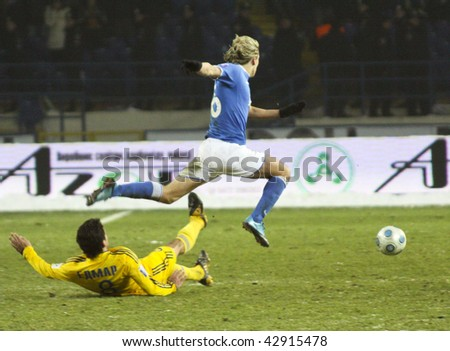 KHARKIV, UKRAINE - DECEMBER 12: Metalist halfback Edmar (N8-Yellow) downed during FC Metalist (Kharkov) - FC Dnepr (Dnepropetrovsk) (3:2) soccer match, December 12, 2009 in Kharkov, Ukraine - stock photo