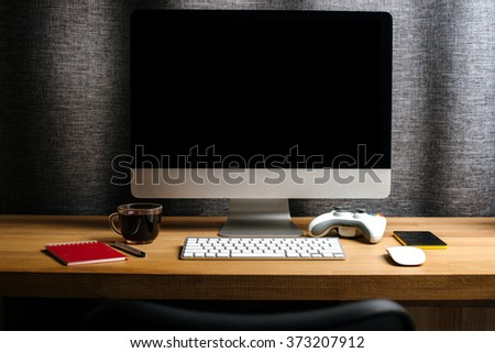 Kharkiv, Ukraine - January 13, 2016: Apple 21-inch iMac Computer on a desk is, accessory, notebook, mouse and smatrfon on the oak table - stock photo