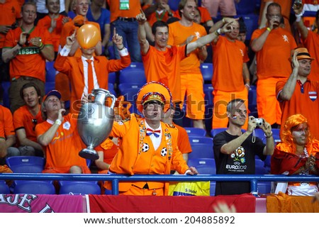 KHARKIV, UKRAINE - 13 June, 2012: Dutch fans show their support at Kharkiv Arena during UEFA EURO 2012 game between Netherlands and Germany - stock photo