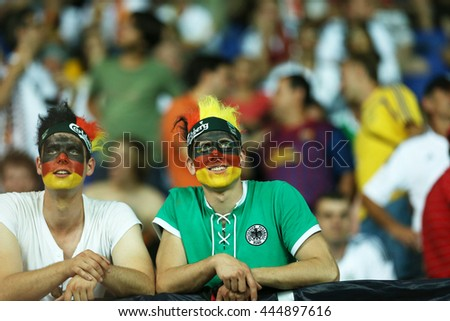 KHARKIV, UKRAINE - JUNE 13, 2012: German fans show their support during UEFA EURO 2012 game of German National football team against Netherlands at 