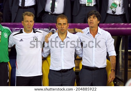 KHARKIV, UKRAINE - 13 June, 2012: Germany national soccer team head coach Joachim Low (R) looks on during UEFA EURO 2012 game against Netherlands  - stock photo
