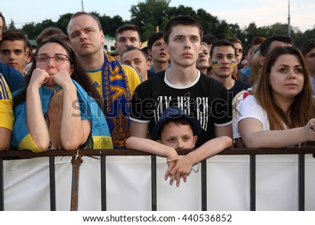 Kharkiv, Ukraine - June 16, 2016: Soccer Ukrainian fans at fanzone during watching TV broadcast of Ukraine-Northern Ireland match of soccer UEFA Euro 2016 Championship.