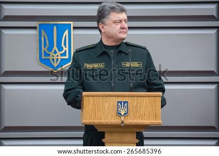 KHARKIV, UKRAINE - Mar. 26, 2015: President of Ukraine Petro Poroshenko during the graduation ceremony of students of the National Academy of the National Guard of Ukraine in Kharkiv - stock photo