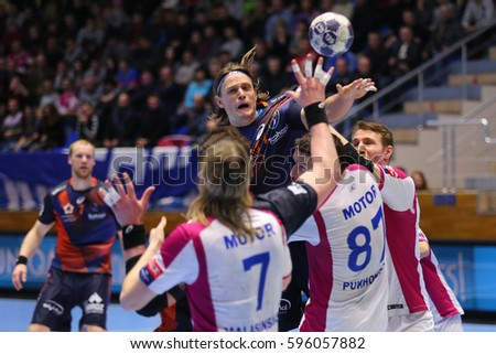 "KHARKIV, UKRAINE - MARCH 4, 2017: DOLENEC Jure shoots against tough defense. EHF Men's Champions League match HC Motor Zaporozhye vs Montpellier HB, Palace of Sports ""Lokomotiv"""