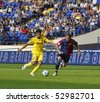 KHARKIV, UKRAINE - MAY 9 : FC Metalist (Kharkiv) midfielder DeLacerda Edmar (L) in action during soccer match vs. FC Arsenal (Kyiv) (1:0), May 9, 2010 in Kharkov, Ukraine - stock photo