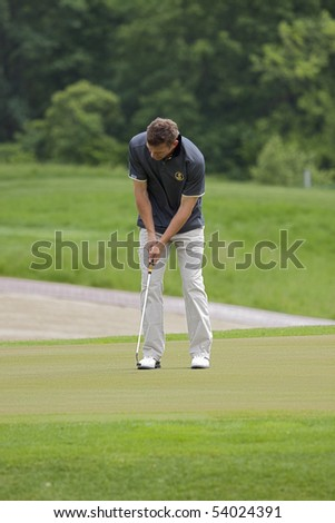 KHARKIV, UKRAINE - MAY 22: Ukrainian football player Andriy Shevchenko plays golf during Ukrainian National football team visit to Superior golf club, May 22, 2010 in Kharkov, Ukraine