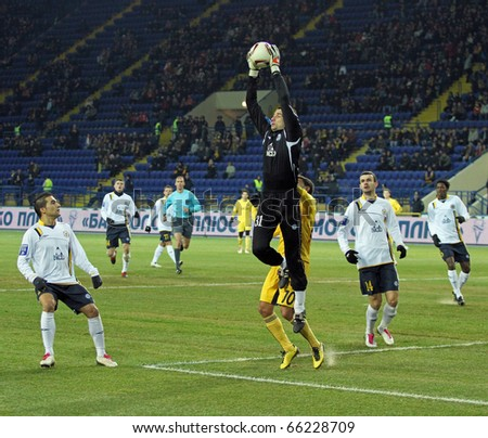 KHARKIV, UKRAINE - NOVEMBER 27: FC Metallurg Donetsk GK Dmytro Vorobyov (C) in action during football match vs. FC Metalist Kharkiv, November 27, 2010 in Kharkov, Ukraine - stock photo