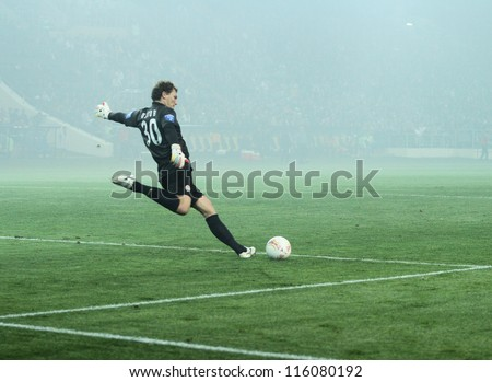 KHARKIV, UKRAINE - OCTOBER 7: FC Shakhtar Donetsk GK Andriy Pyatov in dense smoke during football match vs FC Metalist Kharkiv, October 7, 2012 in Kharkov, Ukraine - stock photo