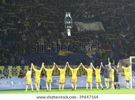 KHARKIV, UKRAINE - OCTOBER 25: Players in action during FC Metallist (Kharkov) - FC Vorskla (Poltava) Ukrainian Prime League Cup soccer match, October 25, 2009 in Kharkov, Ukraine - stock photo