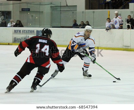 KHARKOV, UA - NOVEMBER 30: Dmitriy Gnitko (R) in action during HC Kharkov vs. Donbass (5:8) ice hockey match, November 30, 2010 in Kharkov, Ukraine