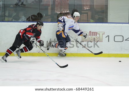 KHARKOV, UA - NOVEMBER 30: Pavel Bolshakov (R) in action during HC Kharkov vs. Donbass (5:8) ice hockey match on November 30, 2010 in Kharkov, Ukraine