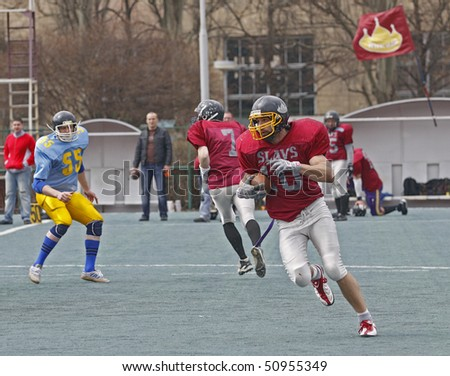 KHARKOV, UKRAINE - APRIL 9: Slavs WR - Yuri Gudnich, 10 (R) in action during Atlants (Kharkov) vs. Slavs (Kiev) comrade's football match April 9, 2010 in Kharkov, Ukraine.
