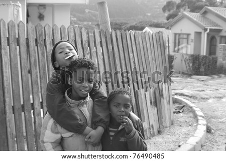 KHAYELITSHA, CAPE TOWN - MAY 22 : A unidentified group of young boys play in a street of Khayelitsha township, on May 22, 2007, Cape Town, South Africa - stock photo