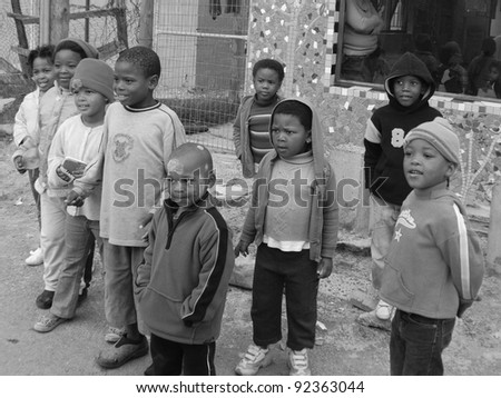KHAYELITSHA, CAPE TOWN - MAY 22 : A unidentified group of young children play on a street of Khayelitsha township, on May 22, 2007, Cape Town, South Africa