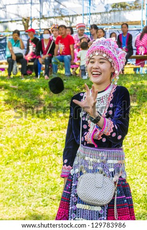 KHEK NOI, PHETCHABUN. THAILAND - DECEMBER 16: Unidentified traditionally dressed Hmong hill tribe girl play a ball in Hmong new year festival on December 16, 2012 in Phetchabun, Thailand. - stock photo