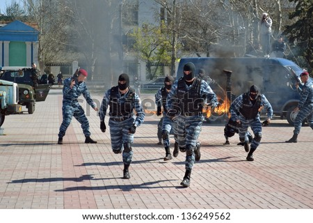 KHERSON, UKRAINE - APR 22: anti-terrorist special units show their skills at the show on April 22, 2013 in Kherson, Ukraine. Ukrainian special units actively participate in UN peacekeeping operations. - stock photo