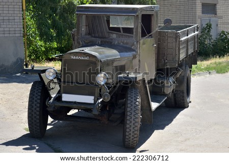 KHERSON, UKRAINE - JULY 2, 2014: a well-preserved retro soviet most widely spread 3 tons truck of WWII period produced at Ural automobile plant. - stock photo