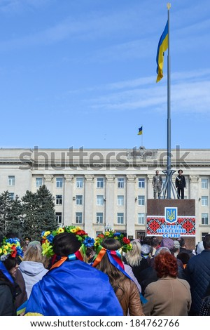 KHERSON, UKRAINE - MARCH 30, 2014: demonstrators for integrity of Ukraine against Russian intervention and unveiling of a memorial to recently fallen for democracy heroes instead of deposed Lenin. - stock photo