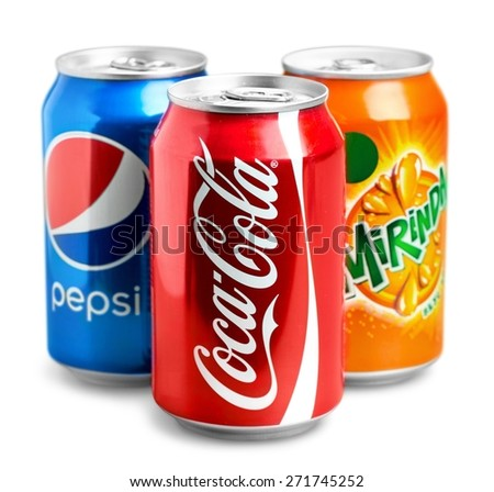 KHERSON, UKRAINE - NOVEMBER 13, 2014: &quot. 0,33l Coca-Cola cans Isolated On White Background. Coca-Cola is a carbonated soft drink sold in shops, restaurants, and vending machines around the globe. - stock photo