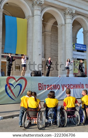 "KHERSON, UKRAINE - SEPTEMBER 21, 2014: a local popular Ukrainian police band ""General Voice"" sing on Day of Town foundation special festivity in favor of cerebral palsy handicapped persons. - stock photo"