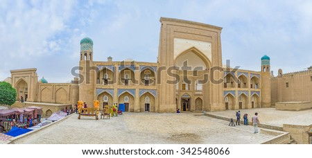 KHIVA, UZBEKISTAN, MAY 3, 2015: The Allakuli Khan Madrasah is the perfect example of the medieval architecture and the famous tourist destination in town, on May 3 in Khiva.
