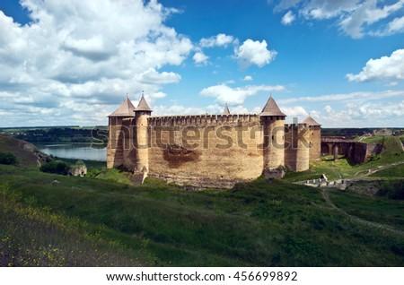 Khotyn castle on Dniester riverside. Dramatic blue sky. Ukraine - stock photo