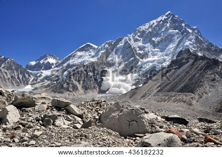 Khumbutse and Nuptse (with avalanche) summits and other. Himalayas mountain panorama view from way to Everest Base Camp - Sagarmatha National Park, Nepal. - stock photo
