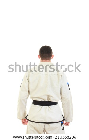 Kickbox fighter wearing kimono with black belt in back view, Jiu jitsu karate sportsman with turned back preparing for fight - stock photo