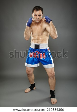 Kickbox or muay thai fighter in guard stance - stock photo