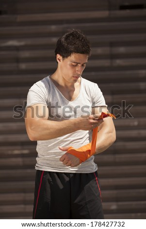Kickboxing athlete male preparing him self - stock photo