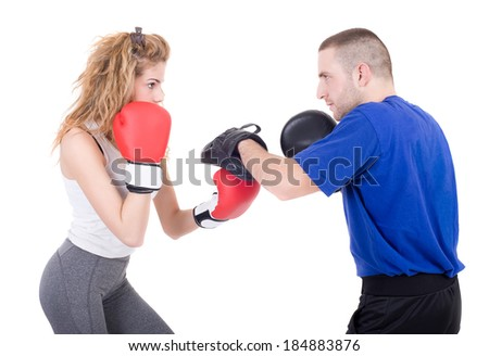 Kickboxing girl with trainer in sparring. Isolated on a white background. Studio shot - stock photo