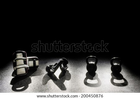 Kickboxing Pads Gloves Kettle Bells - stock photo