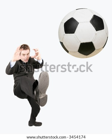 kicking the ball high - stock photo