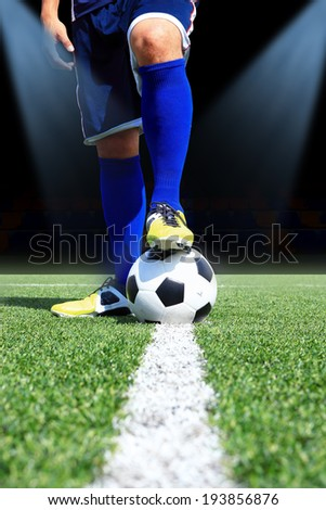 Kicking the soccer ball - stock photo