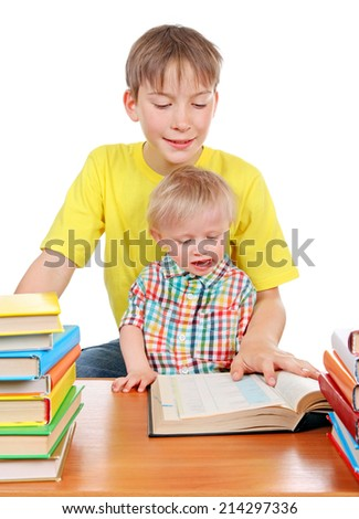 Kid and Baby Boy with the Books at the Desk Isolated on the White Background - stock photo