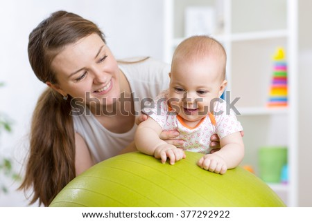 kid and mother with fitness ball - stock photo