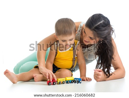 kid boy and his mom play with toy - stock photo