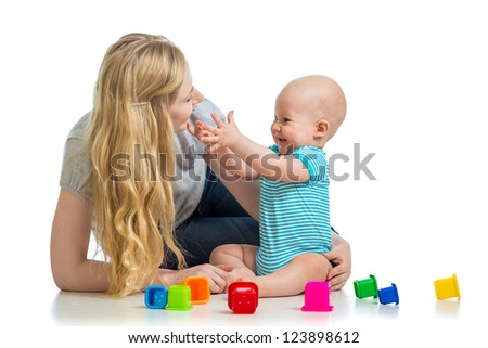 kid boy and mother play together with toys - stock photo