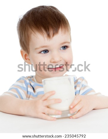 kid boy drinking milk or yogurt from glass isolated - stock photo