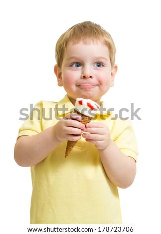 Kid boy eating ice cream with pleasure  isolated on white - stock photo