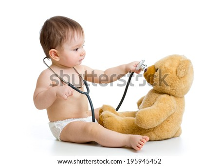 kid boy playing doctor with toy - stock photo