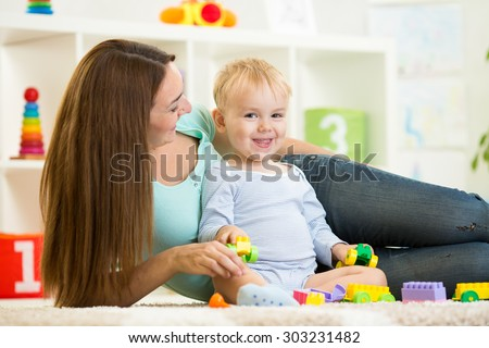 kid boy playing with building blocks at home or kindergarten - stock photo