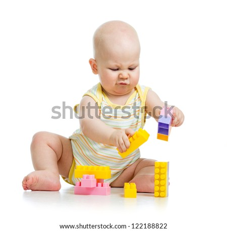kid boy playing with construction set over white background - stock photo