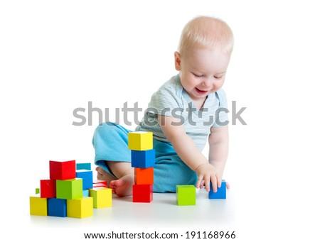 kid boy playing  wooden block toys - stock photo