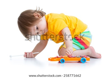 kid boy toddler playing with toy car indoors - stock photo