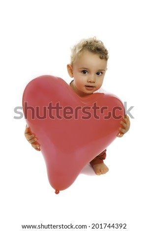 kid crouching with a red hearted balloon - stock photo