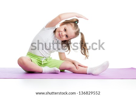 Kid doing fitness exercises - stock photo
