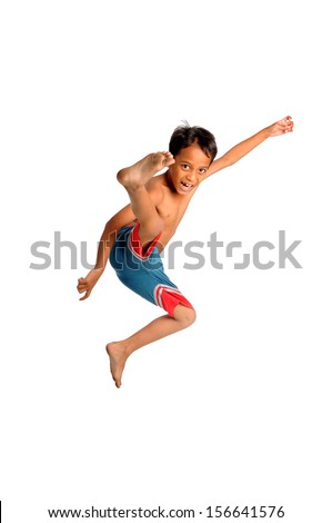 Kid doing flying kick isolate on white background - stock photo
