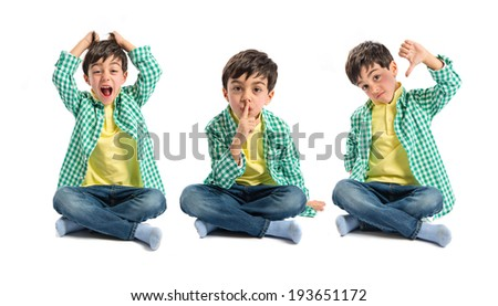 Kid doing silence gesture, bad sign and shouting - stock photo